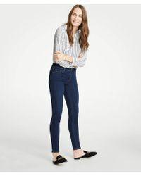 Ann Taylor - Tall Performance Stretch Skinny Jeans In Mid Indigo Wash - Lyst