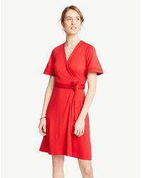 def266d570c Ann Taylor - Petite Flutter Sleeve Wrap Dress - Lyst