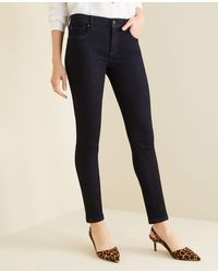 Ann Taylor - Petite Curvy Sculpting Pockets Skinny Jeans In Classic Rinse Wash - Lyst