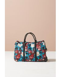Anthropologie - Floral Overlay Rolling Duffle Bag - Lyst