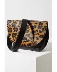 Anthropologie Sac à bandoulière en cuir imprimé léopard - Noir