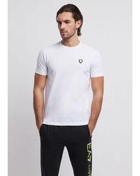 Emporio Armani T-shirt en coton stretch avec logo EA7 - Blanc