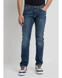 Emporio Armani Jeans J06 in Slim Fit aus verwaschenem Denim - Blau