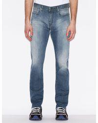Armani Exchange Pantalones cinco bolsillos de denim J13 slim fit - Azul
