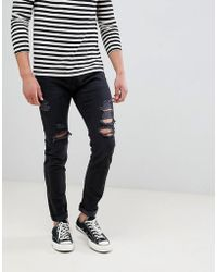 Abercrombie & Fitch - Skinny Fit Destroyed Jeans In Black - Lyst