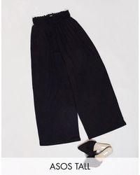 ASOS ASOS DESIGN Tall - Pantalon froncé à la taille style jupe-culotte - Noir