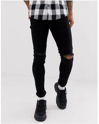 TOPMAN Jeans skinny neri con strappi alle ginocchia - Nero