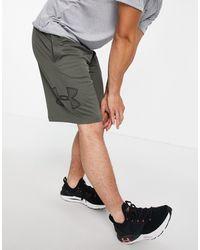 Under Armour Shorts color caqui con estampado gráfico - Verde