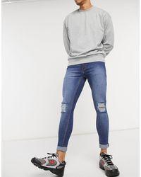 Criminal Damage – e Skinny-Jeans im Destroyed-Look - Blau