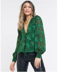 Never Fully Dressed Top avvolgente con maniche voluminose e stampa leopardata, colore verde