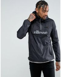 Ellesse - Overhead Jacket With Reflective Logo In Black - Lyst
