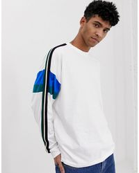 ASOS Oversized Long Sleeve T-shirt With Sleeve Cut And Sew And Taping - White
