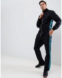ASOS Slim Fit Flightsuit In Black With Green Side Tape