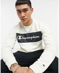 Champion Желтовато-белый Свитшот С Круглым Вырезом И Темно-синим Принтом