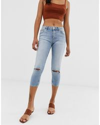 ASOS Lisbon Mid Rise Cropped Skinny Jeans In Mid Stone Wash With Ripped Knees - Blue