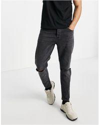 TOPMAN Stretch Tapered Jeans Knee Rip - Black