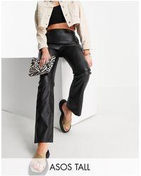 ASOS ASOS DESIGN Tall - Pantalon taille basse évasé à empiècements en PU - Noir