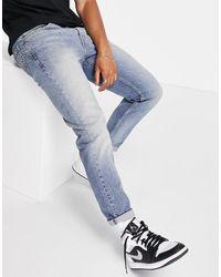 Levi's – 502 – Schmal zulaufende Hi-Ball-Jeans mit Vintage-Waschung - Blau