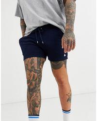 ASOS Short coupe skinny en jersey avec triangle - Bleu marine