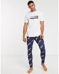 ASOS – Lounge-Pyjama aus Meggings and T-Shirt mit römischen Zahlen bedruckt - Blau