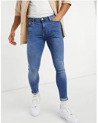 River Island Spray On - Jeans skinny lavaggio blu medio