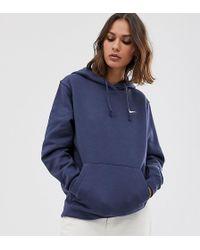 Nike Hoodie oversize à petit logo virgule - Bleu délavé