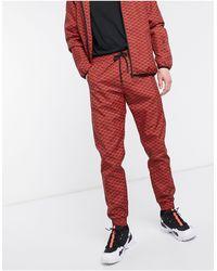 Criminal Damage Nylon Tracksuit Pant - Red