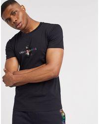 Calvin Klein Cavin Klein Jeans - Pride - T-shirt avec petit logo monogramme arc-en-ciel - Noir