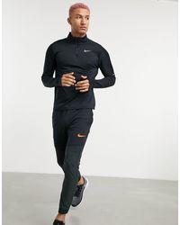 Nike  – Element – es Oberteil mit kurzem Reißverschluss - Schwarz