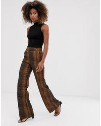 & Other Stories Pantalones de pernera ancha con estampado de serpiente color teja - Multicolor