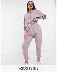 ASOS ASOS DESIGN Petite – Grell verwaschener Trainingsanzug mit Kapuzenpullover und Jogginghose - Lila