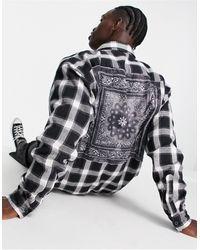 Mennace Camisa negra extragrande con panel con estampado - Negro