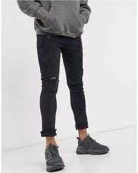 ASOS Jeans super skinny nero slavato strappati - Multicolore