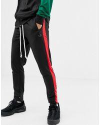 Criminal Damage Skinny jogger In Black With Side Stripe