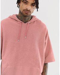 ASOS Sudadera con capucha extragrande de manga corta en rosa con parte posterior de rizo
