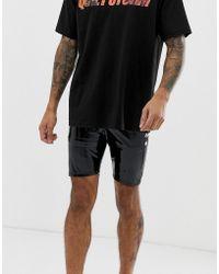 ASOS - Pantalones cortos estilo megging negros de efecto mojado de - Lyst