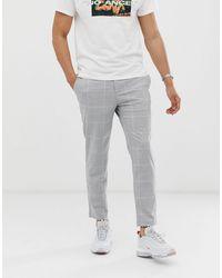 Bershka Pantalones capri ajustados a cuadros en gris claro