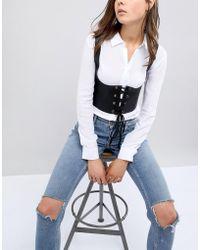 ASOS Ceinture style corset avec détail harnais - Noir