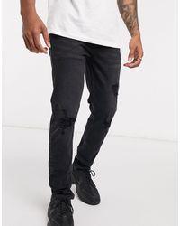 ASOS - Vaqueros ajustados en negro desgastado con roturas en la rodilla - Lyst