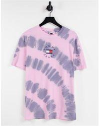 Tommy Hilfiger – Limited Capsule – T-Shirt mit Flaggenlogo hinten und mehrfarbigem Batikmuster - Lila