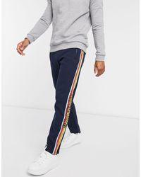 Superdry Cali - Jogger avec rayure sur les côtés - Bleu