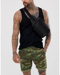 ASOS – Schmal geschnittene Shorts mit Military-Print - Grün