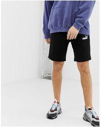 PUMA Pantalones cortos negros Essentials de