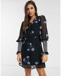 We Are Kindred Havana - Mini-robe smockée à fleurs - Noir