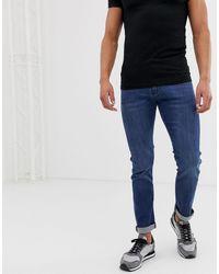 Armani Exchange J13 - Jean slim stretch - délavé moyen - Bleu