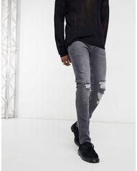 ASOS - Vaqueros ajustados en negro desgastado con roturas marcadas en la rodilla - Lyst
