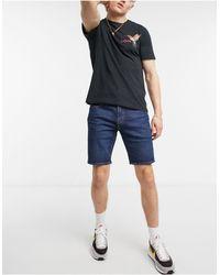Levi's Shorts vaqueros lavado medio con bajos - Azul