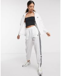 adidas Originals Adicolor Locked Up - Trainingsbroek Met Logo - Wit