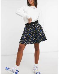 Love Moschino - Черная Мини-юбка Со Звездным Принтом -черный Цвет - Lyst