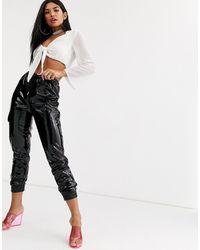 Public Desire Pantalones cargo holgados en vinilo - Negro